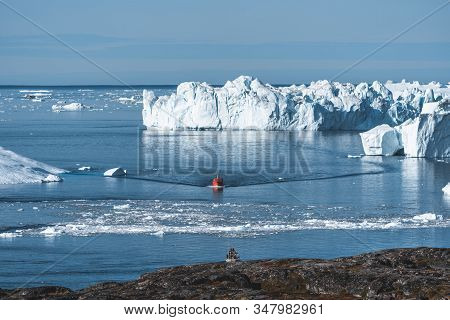 Expedition Boat In The Disko Bay Nearby Of Ilulissat, Greenland. Panoramic Aerial Vew Towards Icefjo