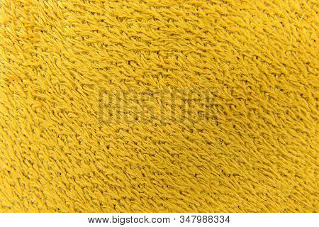 Background From Fleecy Fabric Of Yellow Synthetic Wool