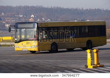 Krakow, Poland 20.12.2019: Yellow Ryanair Bus Solaris Is Driving Along The Runway At The Airport. Or