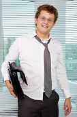 Sloppy businessman with briefcase looking at camera poster