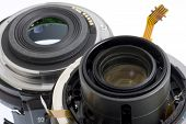 Broken autofocus 60mm lens - two parts with visible electronic circuits poster