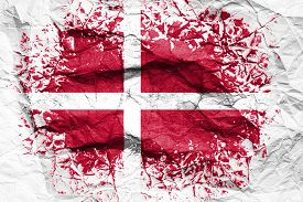 The National Flag Of The Denmark  Is Painted On Crumpled Paper. Flag Printed On The Sheet. Flag Imag