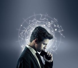 Thoughtful Businessman And A Circle Of Futustic User Interface , Data And Information.