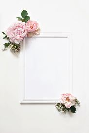 White Blank Wooden Picture Frame Mockup. Wedding Sign Board Still Life Composition With Floral Decor