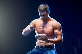 Young Muscular Holding Healthy Food. Diet And Healthy Eating Con