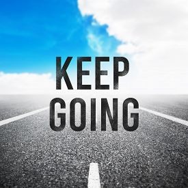 Quote Keep Going Over Asphalt Road. Motivation Concept