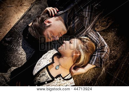 couple looking at each other while laying in opposite directions
