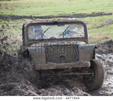 Rally Car Splashing Through The Mud And Water