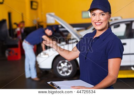 friendly female vehicle service center worker welcome customer