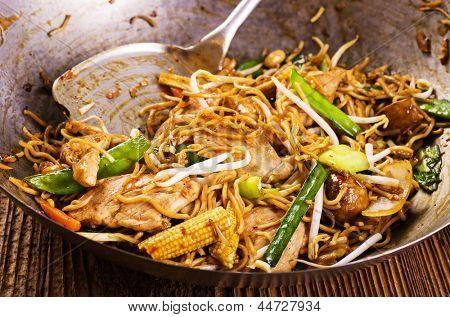 stir fried noodles in wok