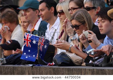 Brisbane, Australia - April 25 : Flag Waving Crowds Line The March Route During Anzac Day Commemorat