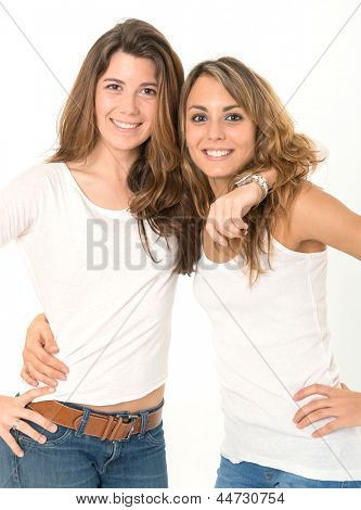 Two female friends against a white background