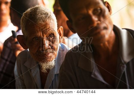 BERDUT, MALAYSIA - APR 8: Portrait of men Orang Asli (malaysian aborigines) on Apr 8, 2013 in Berdut, Malaysia. More 76% of all Orang Asli live below the poverty line, life expectancy - 53 years old.