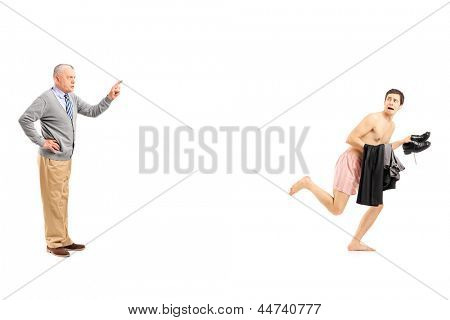 Full length portrait of a mature man shouting at a young naked man running away, isolated on white background