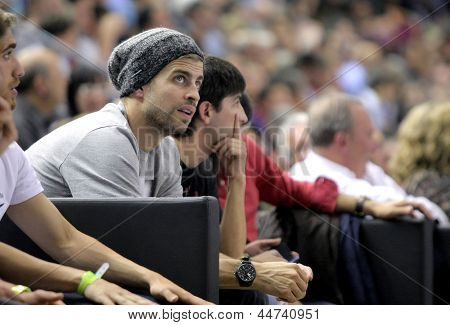 BARCELONA - APRIL, 9: Gerard Pique of FC Barcelona between audience during a Euroleague match between FC Barcelona vs Panathinaikos at the Palau Blaugrana on April 9, 2013 in Barcelona, Spain
