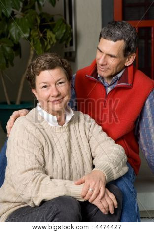 Happy Senior Couple On Front Porch