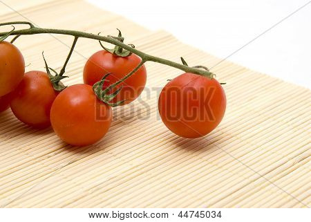 Cherry Tomatoes On Bamboo Place Mat