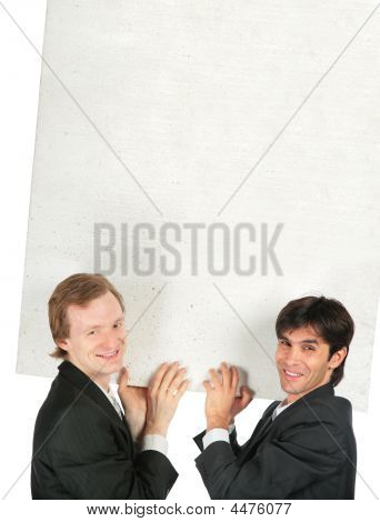 Two businessmen carry white plate foam plastic poster
