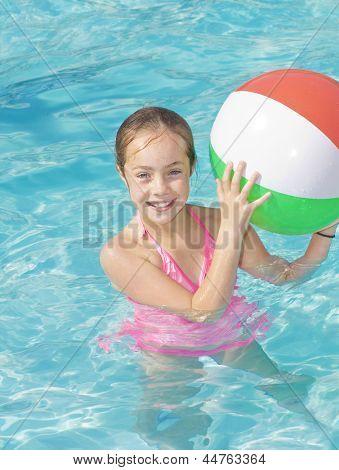 Cute Girl Playing in a Swimming Pool