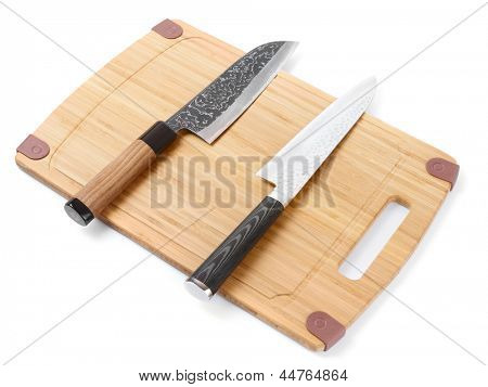 Pair of high quality japanese knifes on cutting board, isolated