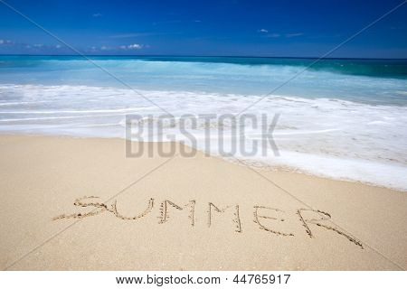 Beautiful tropical beach with the word summer written on the sand