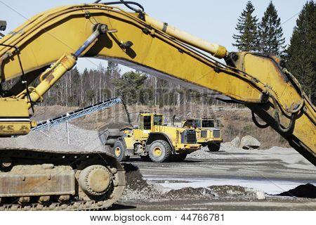 bulldozer, trucks and gravel pits