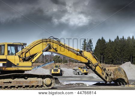 bulldozers, diggers excavating inside stone and rock industry,
