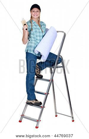 Women climbing a step ladder