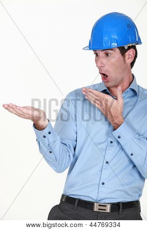 Engineer looking at his hand in amazement