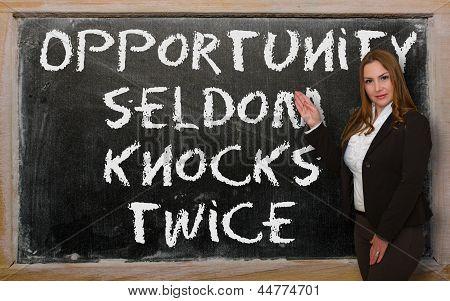 Teacher Showing Opportunity Seldom Knocks Twice On Blackboard
