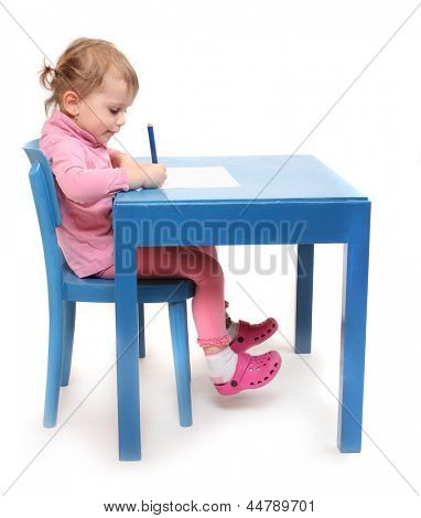 Little scholar in the school desk.