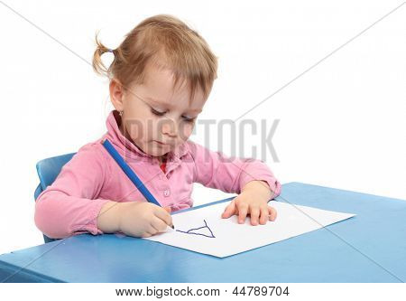 Little scholar in the school desk. poster