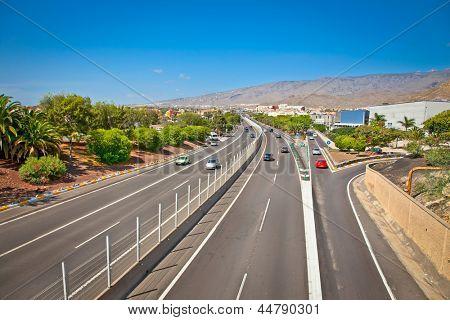 Highway TF-1 in Adeje on Tenerife, Spain. poster