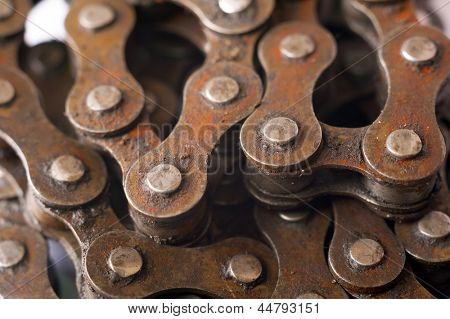 Old dirty rusty bicycle chain