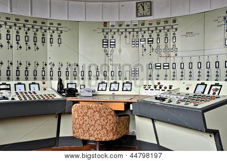 a control panel with many lamps in a disused mine
