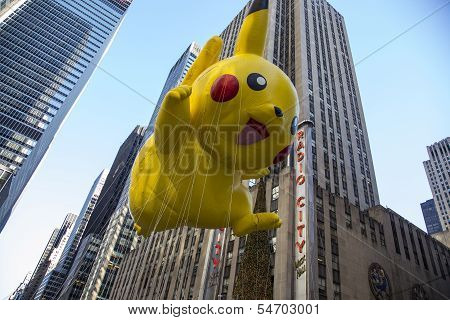 Pikachu balloon passing Radio City Music Hall