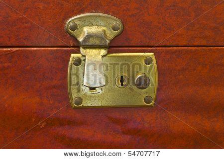 Unlocked Brass Latch On Vintage Luggage
