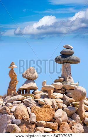 Stone figures on beach shore of Illetes beach in Formentera Mediterranean Balearic Islands