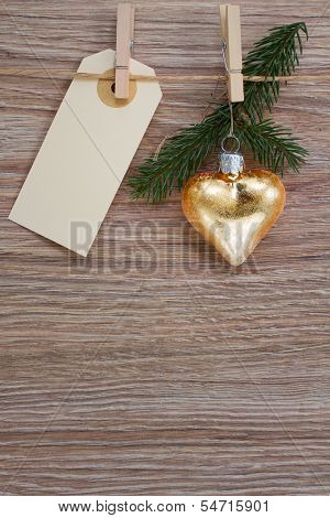 golden heart and evergreen twig with tag