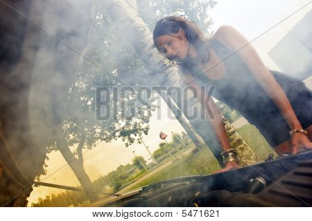 Woman Looking At Blown Engine