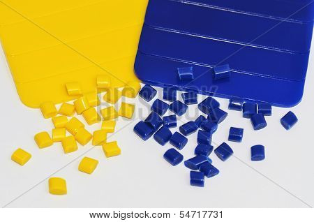 blue and yellow colour samples with corresponding polymer resins in a colour laboratory poster