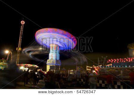 A Ferry wheel in motion in Carnival