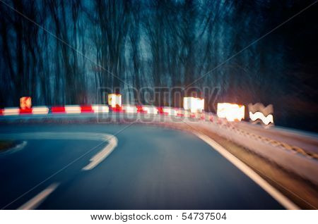 Caution - driving on a curvy country road. poster