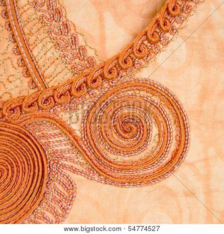 Traditional embroidery on fashionable feminine clothing, Senegal, Africa