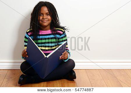 happy child reading a book