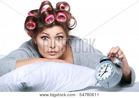 happy positive young  woman waking up and switching off the alarm clock