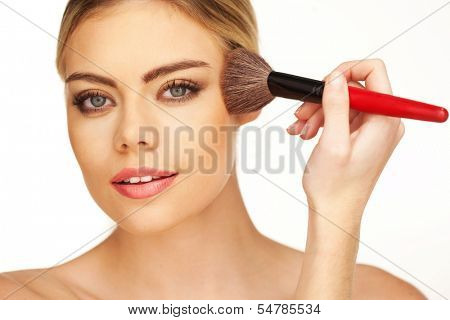 Closeup portrait of young beautiful girl with perfect skin and curly hair. Powder and foundation make up by soft brush