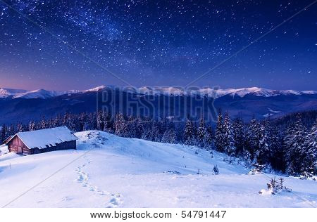 The Milky Way over the winter mountains landscape. Carpathian, Ukraine, Europe. Beauty world.