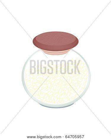 A Jar Of White Sesame On White Background