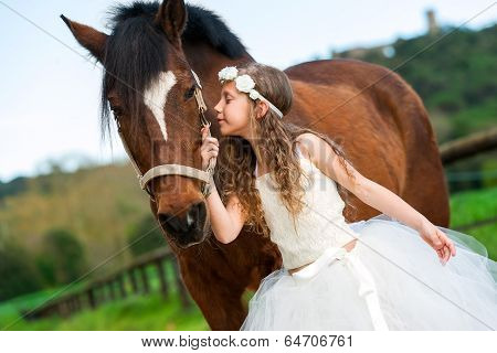 Girl Giving Horse A Kiss